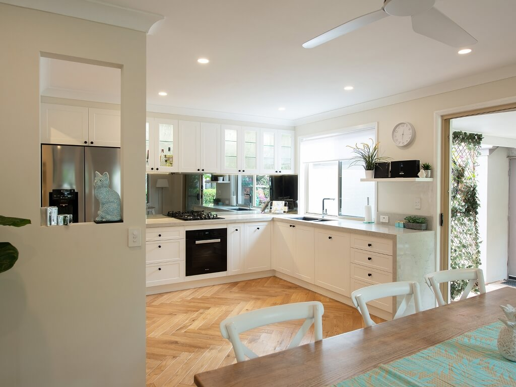 Large renovated Brisbane Hampton kitchen with mirror splashbacks