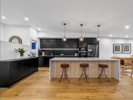 Renovated Brisbane kitchen with island bench and stools