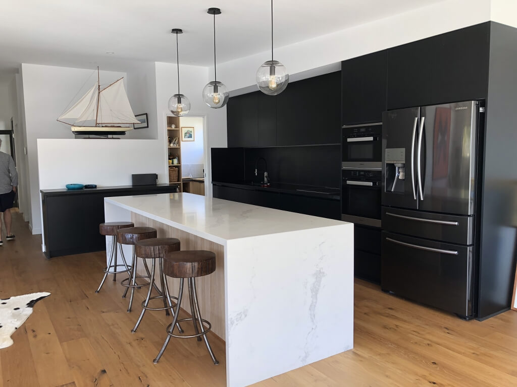 Black renovated Brisbane kitchen with white island